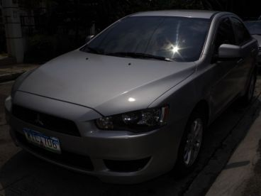 mitsubishi lancer ej 2011 how to turn on aux